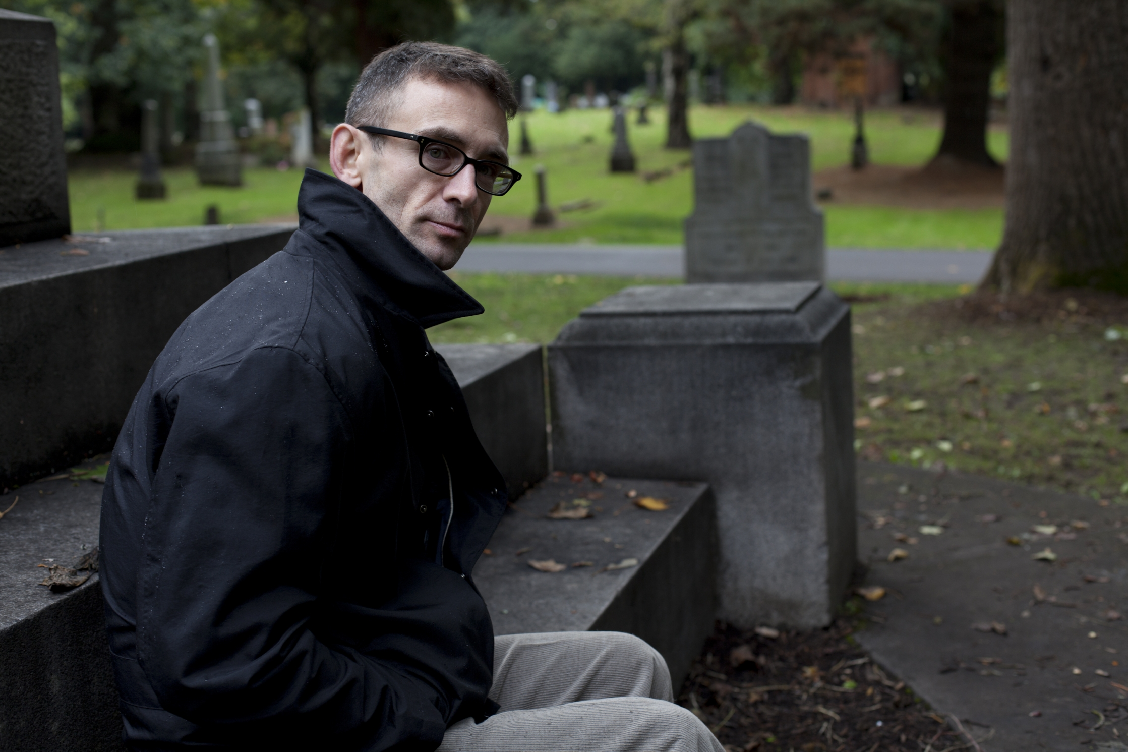 Chuck Palahniuk in Portland, Oregon. (cemetary is Lone Fir Cemetary) Image © Tim LaBarge